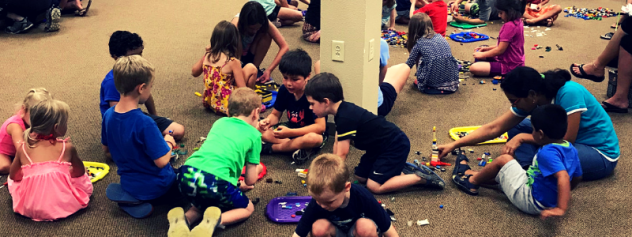 Group of kids building with Legos