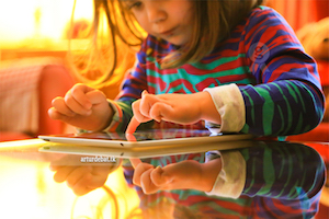Child touching tablet