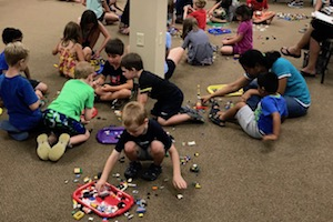 Group of children building with Legos