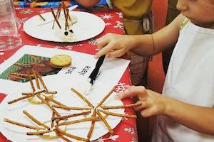 Child making a pretzel snack