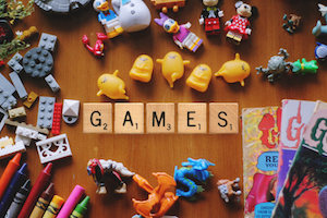 Scrabble tiles spelling games with toys around