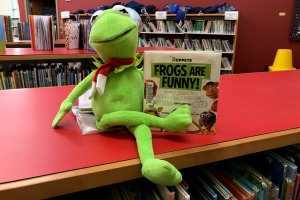 Kermit puppet and book on a table