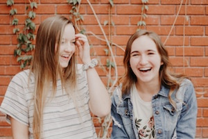 Two smiling teens
